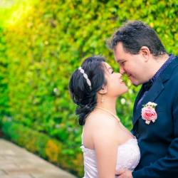 couple kissing in Merrimu Receptions garden captured by wedding photographers Black Avenue Productions