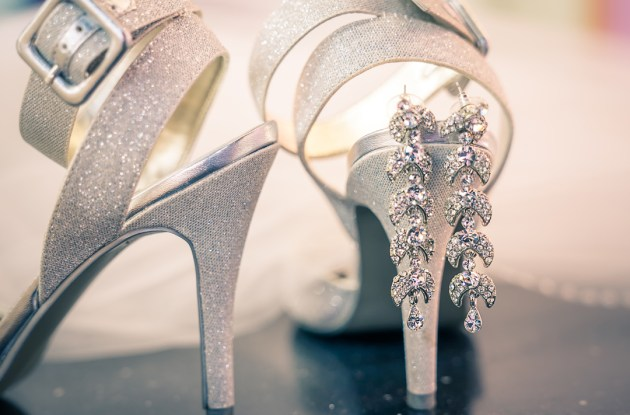 wedding photography of silver wedding high heel with earrings artistically composed