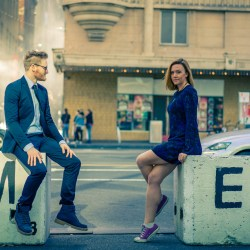 Melbourne engaged couple sitting by MoVida for their engagement photo session