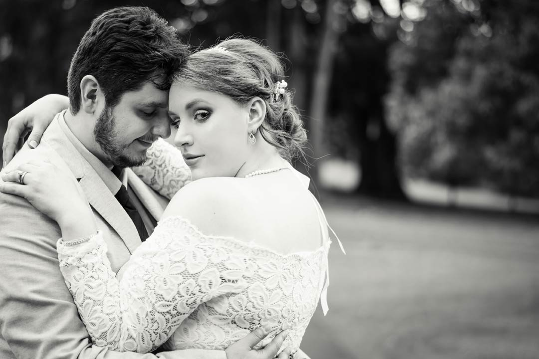 dream wedding picture in black and white with classic look bride and loving groom in garden near Victorian Marriage Registry