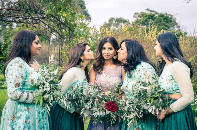 greenery wedding photo idea showing green bridesmaid dresses and woolly flower bouquet
