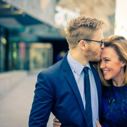 Happy bride to be 2018 smile to her fiancé in front of ACMI Melbourne during her engagement photo session