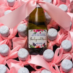 personalised wine bottles with pink ribbon for wedding
