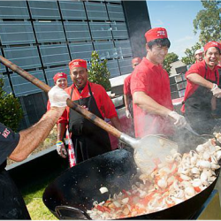 team from Flying Woks stir fly paella for wedding in Melbourne