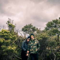 artistic modern couple photography showing lovers in casual attire walking through the woods in Australia Mornington peninsula