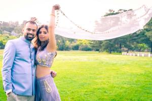 stunning image of bride and groom with flying veil in Melbourne rustic wedding venue Baxter Barn