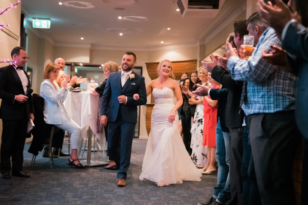 newly wedded bride groom grand entrance to Melbourne wedding reception moment
