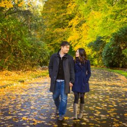 Melbourne engagement photography inspiration showing candid moment of couple walking and hugging at Mt Dandenong Ranges
