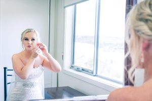 beautiful bride getting ready photo in front of mirror