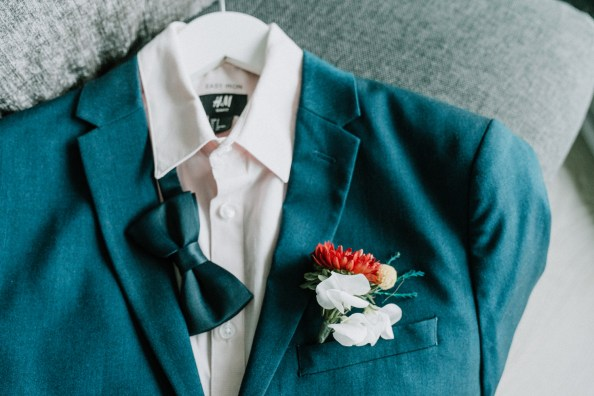 Gay wedding suit with matching corsage