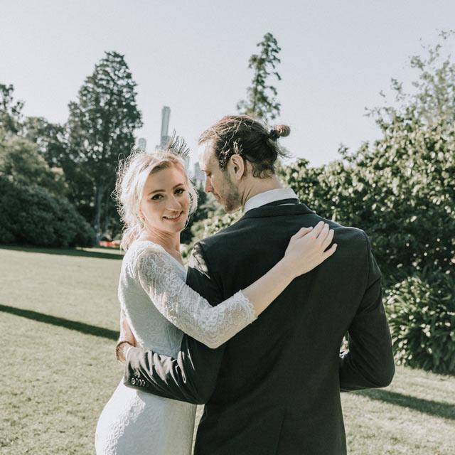 boho bride groom romantic walk in Royal Botanical Garden for their rustic barn wedding Melbourne