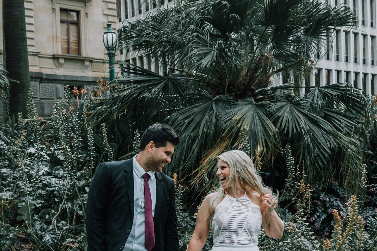 happy couple joking and laughing with each other moment captured by Melbourne wedding photographers Black Avenue Productions