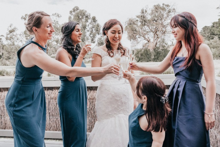 bride cheers champagne with her bridal party at Immerse Yarra Valley wedding reception