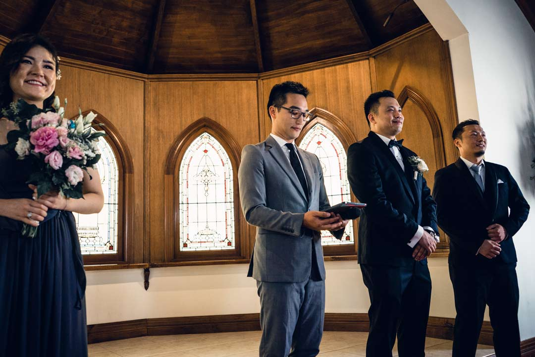 groom waited nervously for his bride to come at chapel wedding ceremony