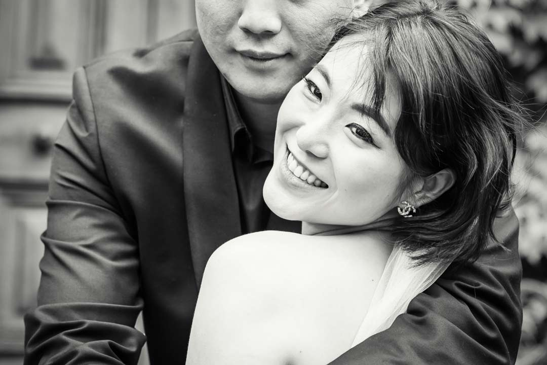 romantic couple photography of a happy girlfriend hugging boyfriend captured by Black Avenue Productions