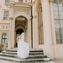 beautiful bride walking to castle wedding reception in Europe real moment captured by Lowina Blackman from Black Avenue Productions