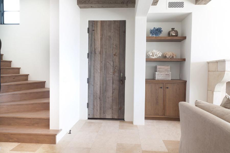 reclaimed wood door and wooden built in shelves