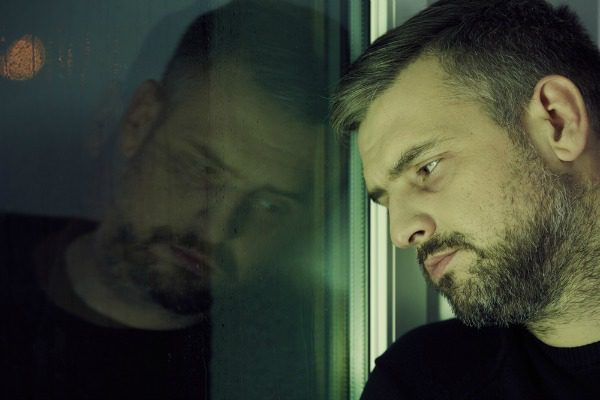 Man contemplating by window