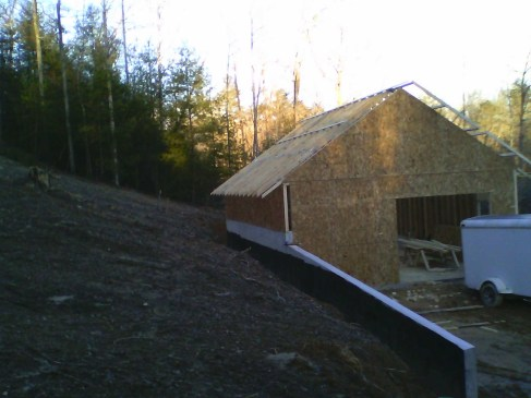 Garage tucked up closer to the hill. Later we removed a lot of that dirt to make a 'road' above the garage