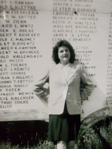 1946: Joy's teenage mother in front of her town's military honor roll