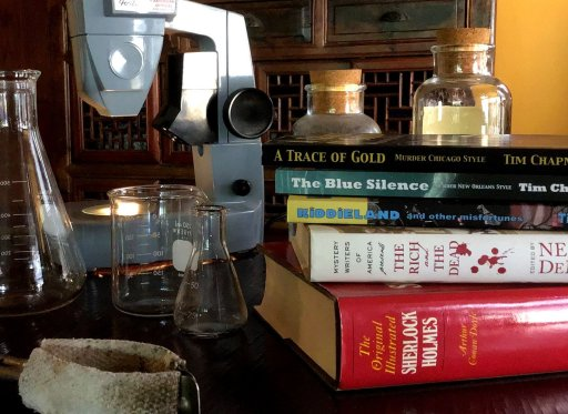Lab glassware and equipment with books by Tim Chapman