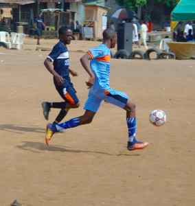 Striker Abolomope Hammed in the thick of the action during the match