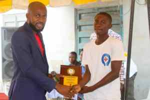 Hon. Toyin Aremu presenting the Award of the best under 13 players of the year