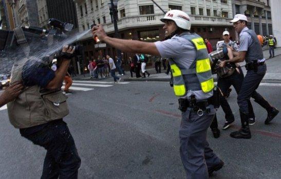 Military Police pepper spray a cinematographer