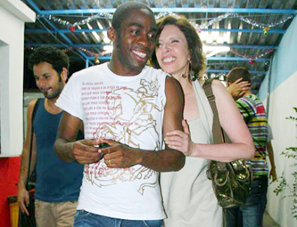 Guigui (Marília Gabriela) and Evilásio (Lázaro Ramos)