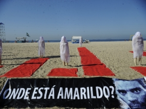 Mannequins mounted in the sand of Copacabana beach in Rio in memory of Amarildo and many others who have disappeared