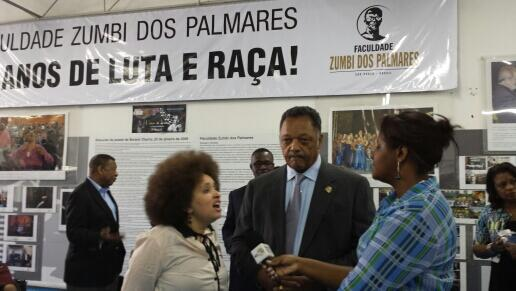 Jackson speaks to the press with the assistance of his interpreter Daniela Gomes