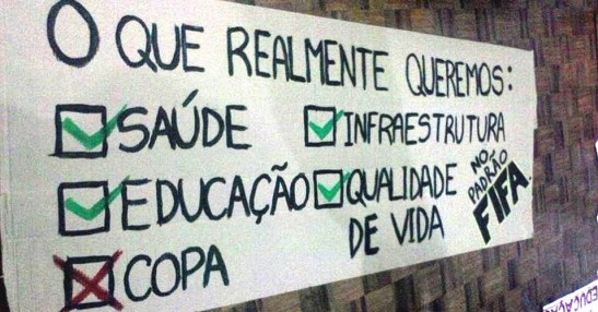 """Sign from June 2013 protests: """"What we really want - Green checks: Health (care), infrastructure, education and quality of life - In FIFA standard Red X: Copa (Cup)"""