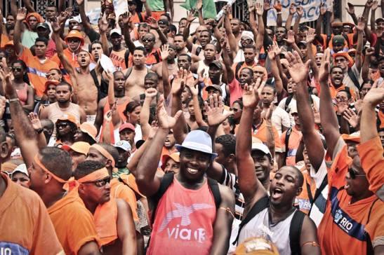 Striking sanitation workers celebrate victory