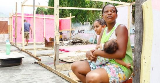 Letícia Lourenço feeds her baby in the favela