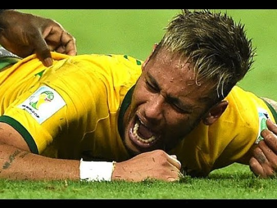 Neymar lays on the field in pain atfer receiving a knee in back from Colombian player Zuñiga