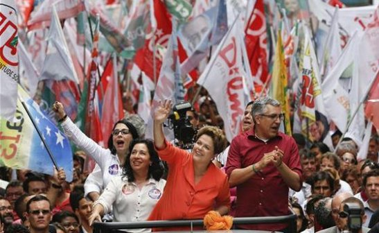 Incumbent Dilma Rousseff waves to supporters in Santos