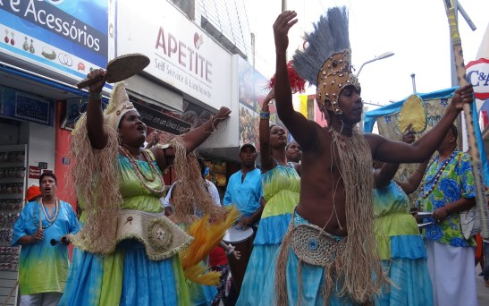 Grupo Afoxé Afaomim performs on mounted stages in downtown Maceió