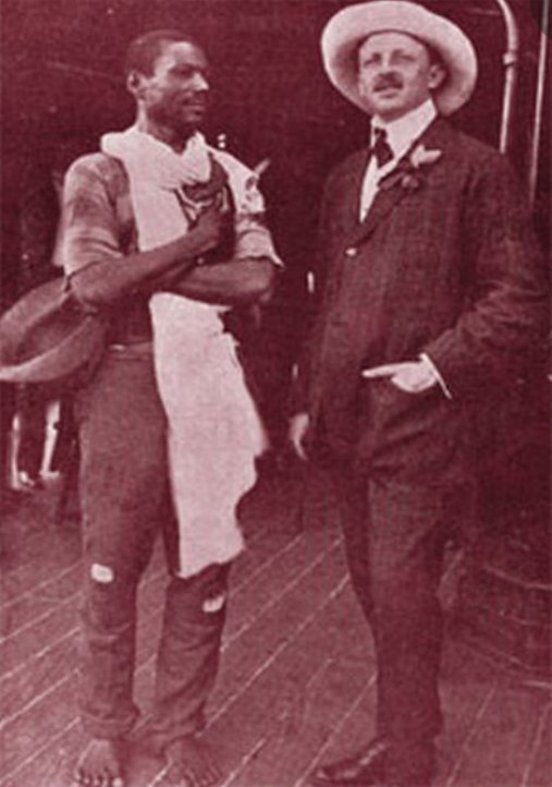 "A black man and a member of the white elite. The first, barefoot, removes his hat as a sign of respect.The second appears extraneous to whom is at his side. The photo is from May 18, 1907 and titled ""Principe Dom Luiz (de Orleans e Bragança (1878-1921) com banhista Santa'Anna que ensinou a nadar na praia do Flamengo."" Abolition maintained the freed in a subaltern position in society."