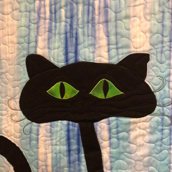 black cat quilt green eyes
