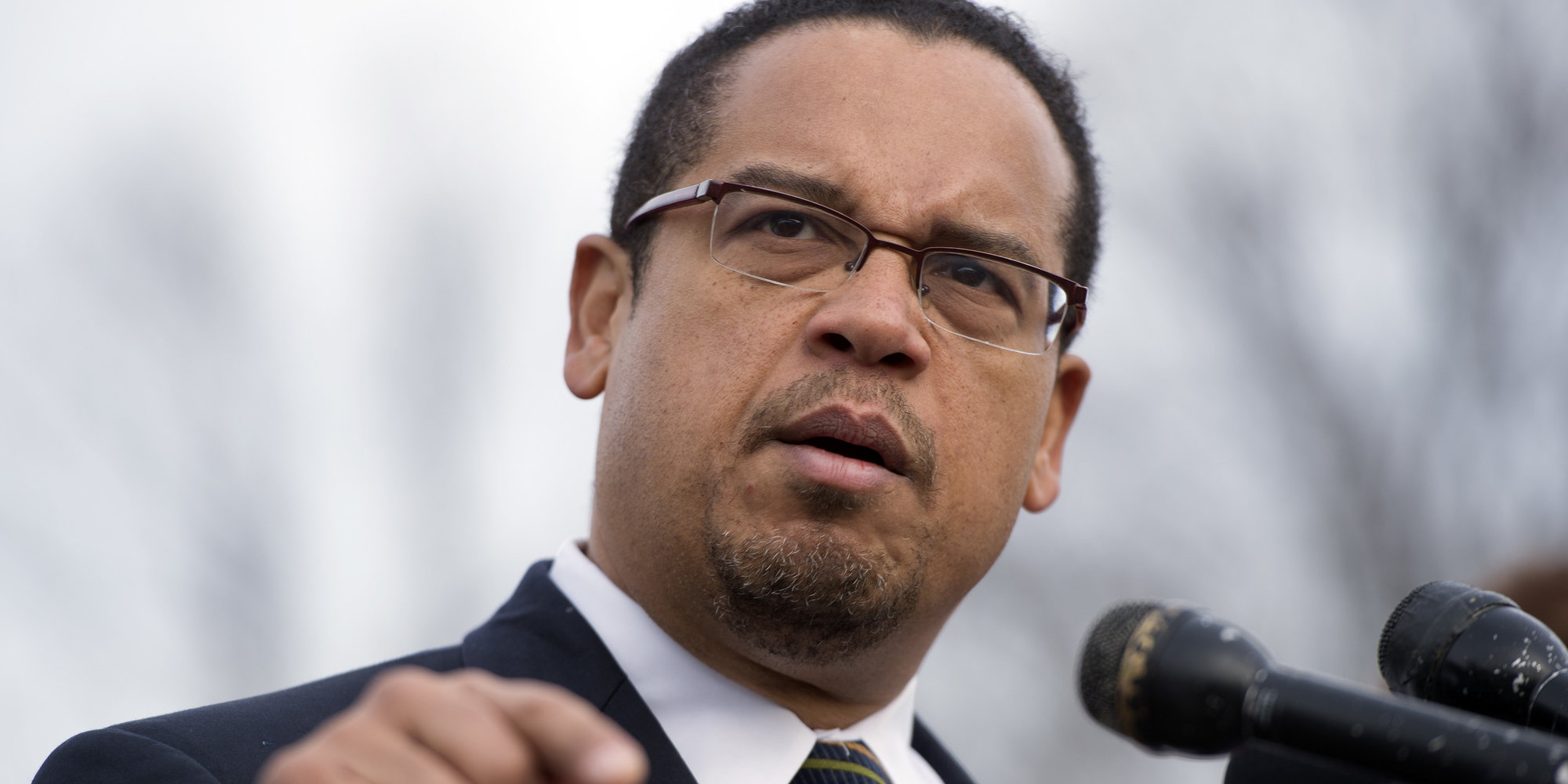"""UNITED STATES - DECEMBER 20: Rep. Keith Ellison, D-Minn., speaks at a news conference at the House Triangle with faith leaders to urge Congress to protect programs such as Social Security, Medicaid, and Medicare and call on lawmakers make sure """"everyone pays their fair share."""" (Photo By Tom Williams/CQ Roll Call)"""