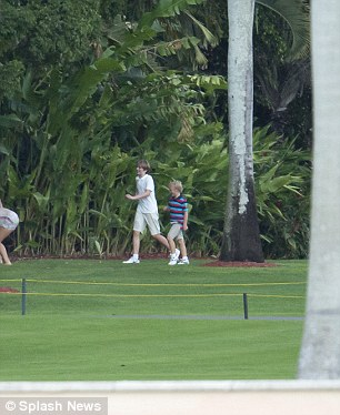 Barron was pictured mingling with other children at the estate