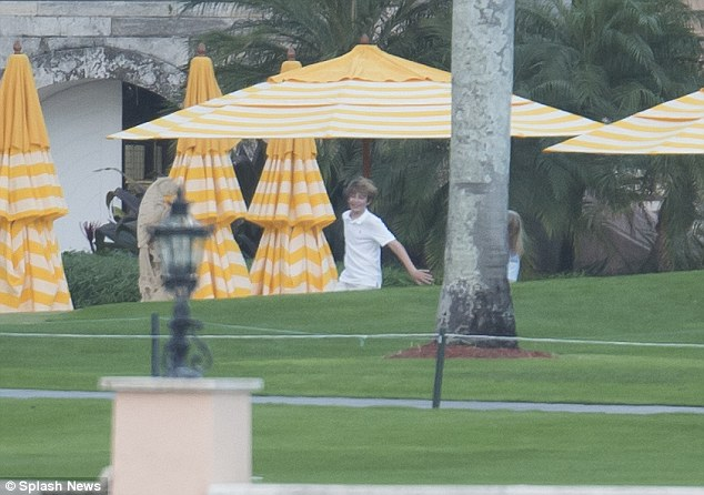 Barron was seen laughing as he ran around on the lawn of the luxury estate last week