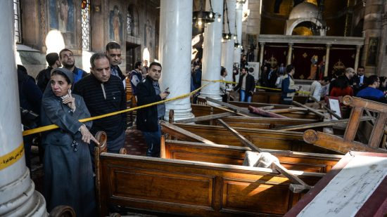 A nun gestures while standing inside the damaged St. Peter and St. Paul Coptic Orthodox Church following a bombing in Cairo, Egypt, 11 December 2016. Reports state at least 25 people were killed and 35 injured on 11 December 2016 in an explosion outside Cairo's Coptic Cathedral in the Abbassia neighborhood. Local media quoting security and Church officials said the explosion occurred in the St. Peter and St. Paul Coptic Orthodox Church, a small chapel attached to the Coptic Cathedral. (EPA/MOHAMED HOSSAM)