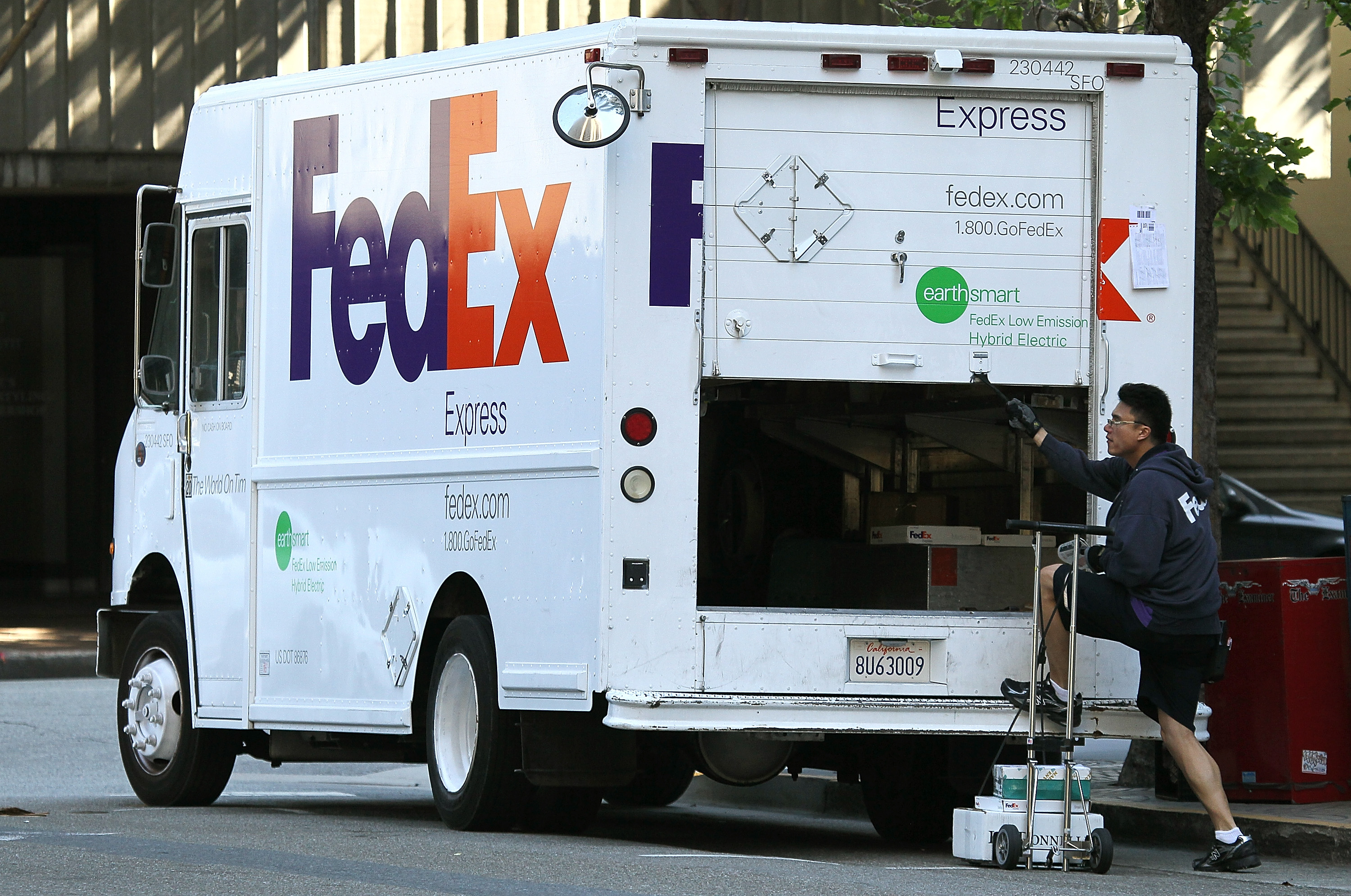 SAN FRANCISCO, CA - JUNE 22:  A FedEx worker steps out of his delivery truck on June 22, 2011 in San Francisco, California.  FedEx Corp. reported a strong fourth quarter with earnings of $558 million, or $1.75 per share compared to $419 million, or $1.33 per share one year ago.  (Photo by Justin Sullivan/Getty Images)