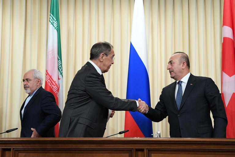 From left, the foreign ministers Mohammad Javad Zarif of Iran, Sergey V. Lavrov of Russia and Mevlut Cavusoglu of Turkey on Tuesday in Moscow. (Natalia Kolesnikova/Agence France-Presse — Getty Images)