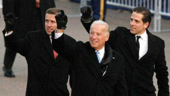 Then-U.S. Vice President Joe Biden walks with his sons Beau (L) and Hunter (R) down Pennsylvania Avenue during the inaugural parade in Washington January 20, 2009.  (REUTERS/Larry Downing)