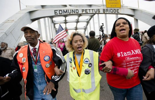 Marches cross the Edmund Pettus Bridge over the Alabama River in Selma on Sunday during the annual re-enactment of the 'Bloody Sunday' demonstration in March 1965. (Albert Cesare / AP)