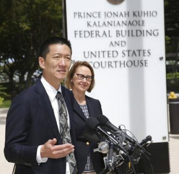 Hawaii Attorney General Douglas Chin, left, and Oregon Attorney General Ellen Rosenblum speak at a press conference outside the federal courthouse, Wednesday, March 15, 2107, in Honolulu. Hearings were scheduled Wednesday in Maryland, Washington state and Hawaii on President Donald Trump's travel ban. The lawsuit claims the ban harms Hawaii by highlighting the state's dependence on international travelers, its ethnic diversity and its welcoming reputation as the Aloha State. (AP Photo/Marco Garcia)