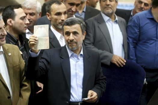 Former Iranian President Mahmoud Ahmadinejad shows his identification during registering his candidacy for the upcoming presidential elections at the Interior Ministry in Tehran, Iran, Wednesday, April 12, 2017.