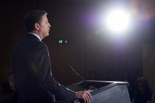 FBI Director James B. Comey makes a statement at FBI headquarters. (Cliff Owen/AP)